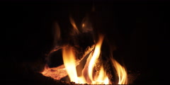 Flickering flames above a small wood fire - stock footage