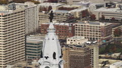 Past statue of William Penn atop Philadelphia City Hall. Shot in 2011. Stock Footage