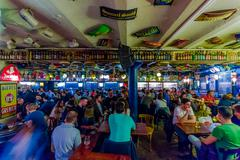 BRUSSELS, BELGIUM - 11 AUGUST, 2015: Famous Delirium Bar inside overview crowded - stock photo