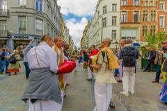 BRUSSELS, BELGIUM - 11 AUGUST, 2015: Hare Krishna street performers dancing in Stock Photos