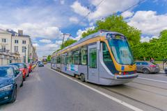 BRUSSELS, BELGIUM - 11 AUGUST, 2015: Blue tram public transportation in traffic - stock photo