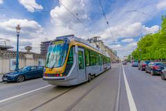 BRUSSELS, BELGIUM - 11 AUGUST, 2015: Blue tram public transportation in traffic Stock Photos