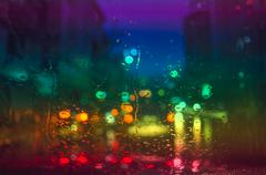 Stock Photo of Raindrops on car glass at night