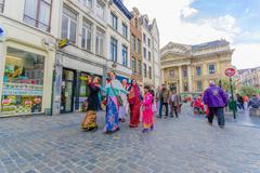 BRUSSELS, BELGIUM - 11 AUGUST, 2015: Hare Krishna street performers dancing in - stock photo