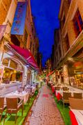 Stock Photo of BRUSSELS, BELGIUM - 11 AUGUST, 2015: Famous street Rue des Bouchers with its