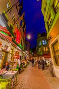 BRUSSELS, BELGIUM - 11 AUGUST, 2015: Famous street Rue des Bouchers with its - stock photo