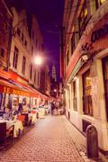 BRUSSELS, BELGIUM - 11 AUGUST, 2015: Famous street Rue des Bouchers with its Stock Photos