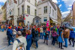 Stock Photo of BRUSSELS, BELGIUM - 11 AUGUST, 2015: Crowd of tourists watching Manneken Pis