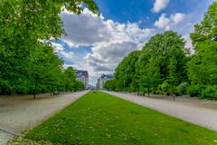 BRUSSELS, BELGIUM - 11 AUGUST, 2015: Pedestrian pathway sorrounded by green park - stock photo