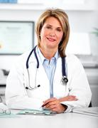 Mature doctor woman in a clinical office. - stock photo