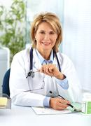 Mature doctor woman with pills. Stock Photos