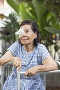Elderly use eye shield covering after cataract surgery. - stock photo