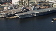 Decommissioned aircraft carriers at the Philadelphia Naval Shipyard. Shot in Stock Footage