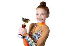 Champion girl holding prize - stock photo
