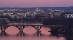 Flying toward the Key Bridge over the Potomac at twilight with Roosevelt Island Stock Footage