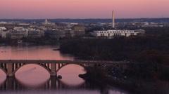 Flying toward the Key Bridge over the Potomac River at dusk in Washington DC; Stock Footage