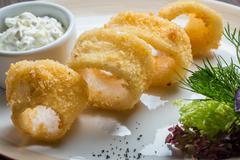 Deep batter fried squid rings calamari - stock photo