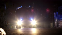 Fire truck with enabled emergency flashing lights at night in a residential Stock Footage