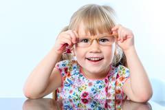 Little girl testing new glasses. Stock Photos