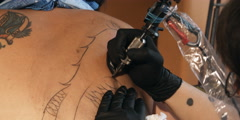 Tattoo being drawn on  a woman's shoulder - stock footage