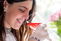Close up of girl smelling wine. Stock Photos