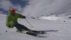 Skier skis around camera slow motion. Stock Footage