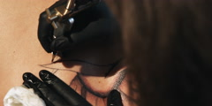 Close-up of tattoo being etched onto skin - stock footage