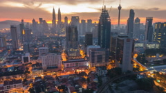 Sunrise Time Lapse at Kuala Lumpur City Centre. Camera tilting from bottom to up Stock Footage