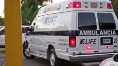 Ambulance car at the street road with blinking lights Stock Footage
