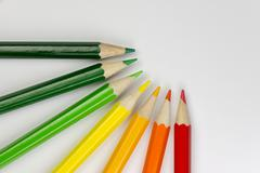 Conceptual crayons as energy label colors. Stock Photos