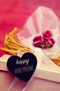 Heart-shaped signboard with the text happy honeymoon Stock Photos