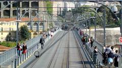 Tramway in Porto on Dom Luis I bridge Stock Footage