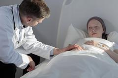 Stock Photo of Doctor's support in sickness