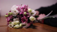 Man came onto a date or meeting with flowers bouquet Stock Footage
