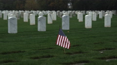American flag in a veterans' cemetery Stock Footage