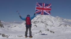 Mountaineer flying British Flag Stock Footage