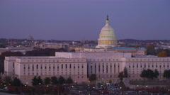 Flying past Senate Office Buildings in front of the Capitol at dusk, Washington Stock Footage