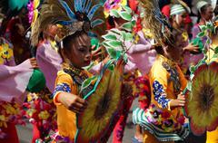 Stock Photo of Street Cultural Orange Dancers