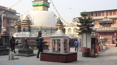 Children play football on the square near the stupa Stock Footage