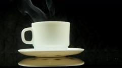 A cup of hot coffee with steam Stock Footage