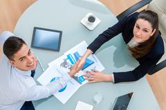 Business partners closing a deal. - stock photo