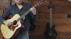 male playing the acoustic guitar slow motion - stock footage