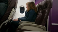 Male and female passengers getting acquainted, talking during flight on plane Stock Footage