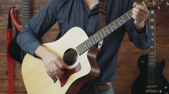 Male playing the acoustic guitar slow motion Stock Footage