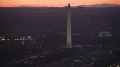 Washington Monument dominating Washington DC cityscape at dusk; Lincoln Memorial Stock Footage