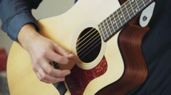 close up man playing the acoustic guitar slow motion - stock footage