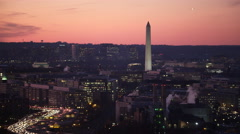 Past the Washington Monument at dusk, traffic on Southwest Freeway in Stock Footage