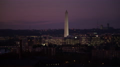 Past the Washington Monument at dusk, National Cathedral on skyline. Shot in Stock Footage