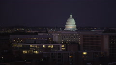 Flying over Southwest District of Washington DC at night, illuminated Capitol Stock Footage