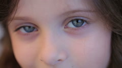 Little girl with amazing eyes smiling looking  camera Stock Footage